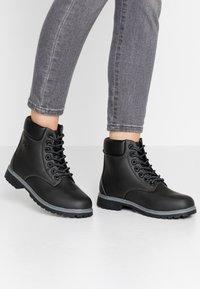 Fila - MAVERICK - Lace-up ankle boots - black - 0