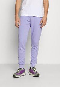 NU-IN - BASIC SLIM FIT JOGGERS - Tracksuit bottoms - light purple - 0
