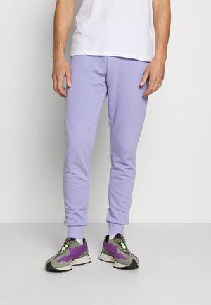 BASIC SLIM FIT JOGGERS - Tracksuit bottoms - light purple