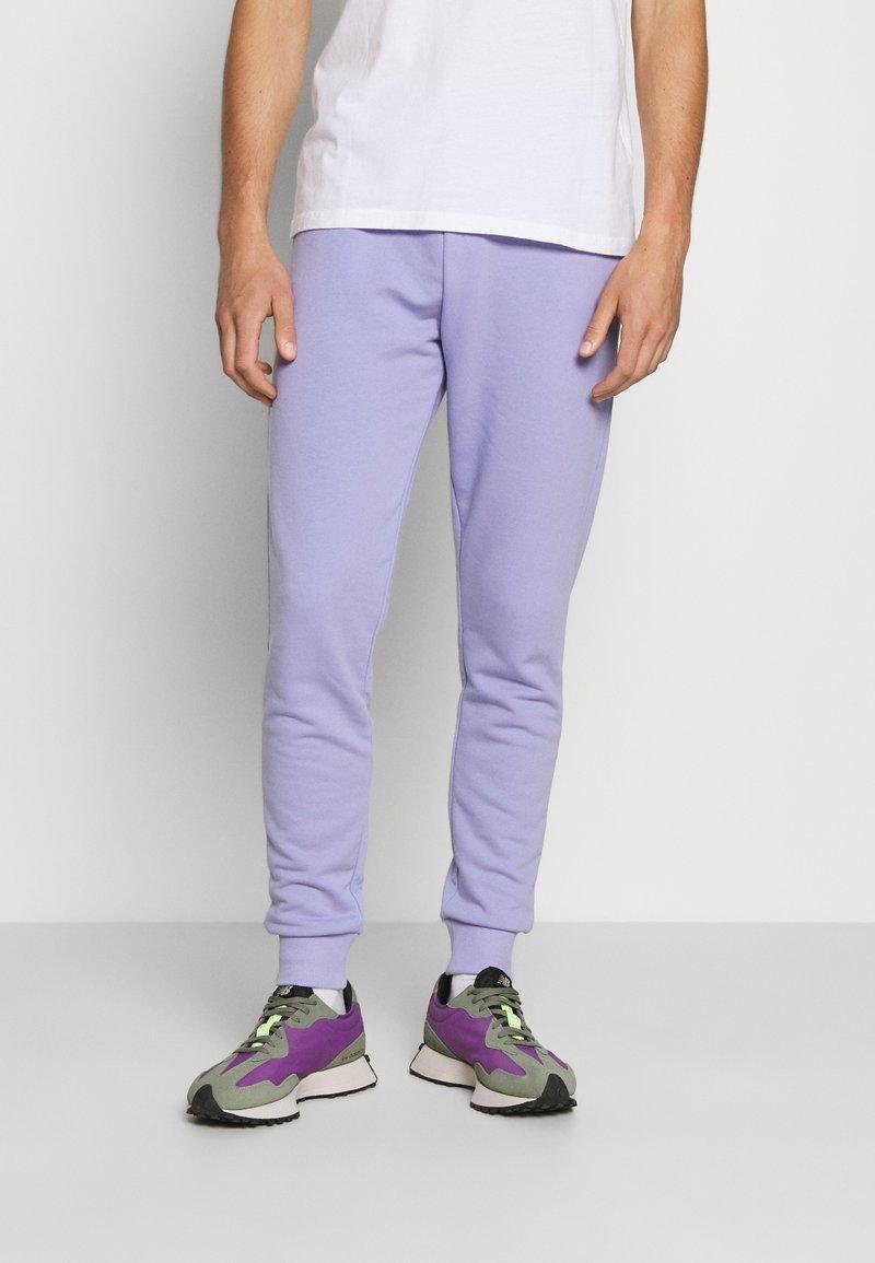NU-IN - BASIC SLIM FIT JOGGERS - Tracksuit bottoms - light purple