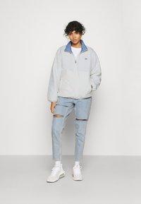 Levi's® - THEA REVERSIBLE  - Winter jacket - white/blue - 1