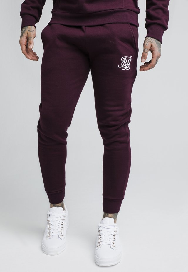 MUSCLE FIT - Tracksuit bottoms - burgundy