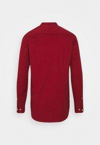Tommy Hilfiger - SLIM STRETCH SHIRT - Shirt - regatta red - 1