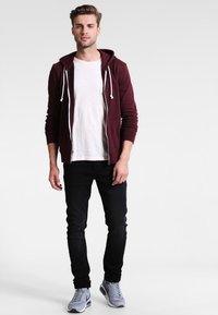Only & Sons - ONSLOOM JOG - Slim fit jeans - black - 1