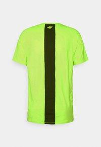 4F - Men's training T-shirt - T-shirt imprimé - neon yellow - 1