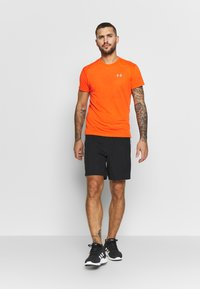 Under Armour - STREAKER SHORTSLEEVE - Sports shirt - ultra orange/reflective - 1