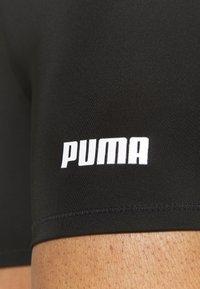 Puma - PAMELA REIF X PUMA MID WAIST SHORT - Tights - black - 6