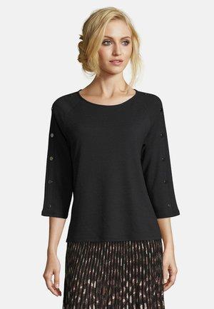 MIT KNOPFLEISTE - Sweatshirt - schwarz