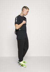 Nike Sportswear - CLUB PANT - Tracksuit bottoms - black/white - 1