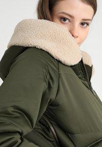 Urban Classics - LADIES SHERPA HOODED JACKET - Winter jacket - dark olive/dark sand - 3