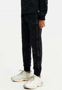 WE Fashion - Trainingsbroek - black - 0