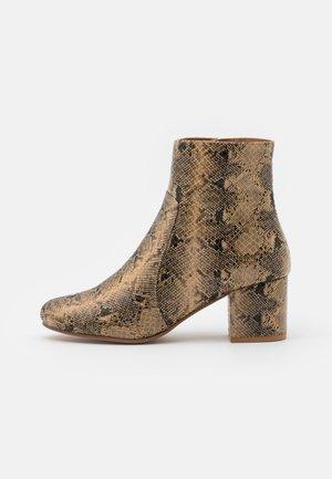 Korte laarzen - gold coloured