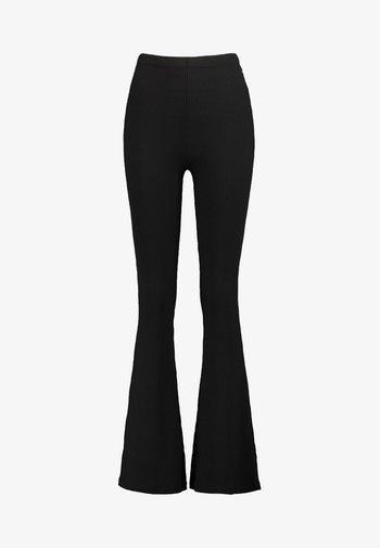 LORI - Trousers - black