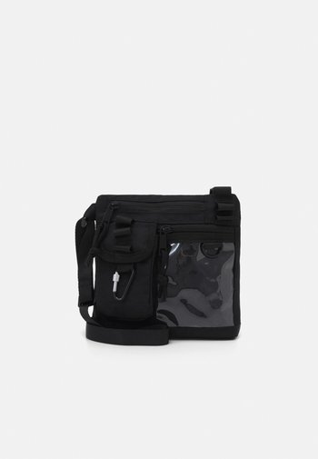 BADGE UTILITY SIDE BAG