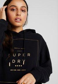 Superdry - OVERSIZED HOODED DRESS - Day dress - black - 6