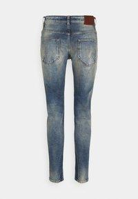Tigha - BILLY THE KID DESTROYED - Slim fit jeans - vintage mid blue - 6
