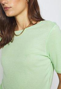Moss Copenhagen - MONA DEEP BACK TOP - Basic T-shirt - pistachio green - 4