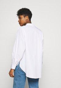 Vero Moda - VMMIE SHIRT  - Button-down blouse - bright white - 2