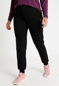 Active by Zizzi - Tracksuit bottoms - black - 0