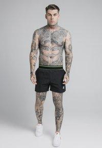SIKSILK - Swimming shorts - black - 1