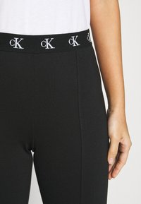 Calvin Klein Jeans - MILANO TRIM - Leggings - Trousers - black - 4