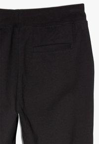 Polo Ralph Lauren - BOTTOMS - Tracksuit bottoms - polo black - 2