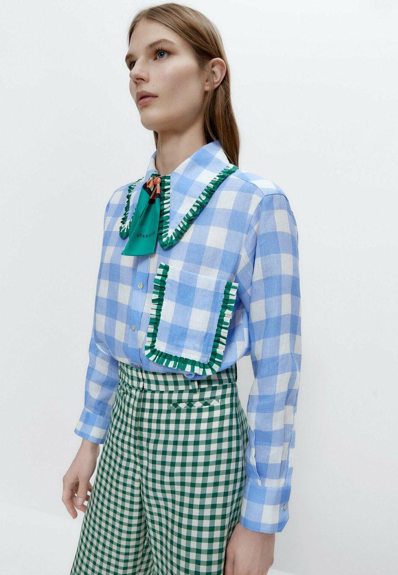 Uterqüe - Button-down blouse - blue denim