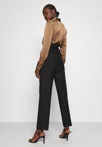 Hope - KEEN TROUSERS - Spodnie materiałowe - black - 2