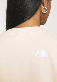 The North Face - CROP TEE - Top sdlouhým rukávem - pink tint - 3