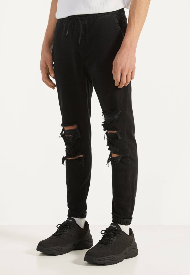 MIT RISSEN - Jeans fuselé - black