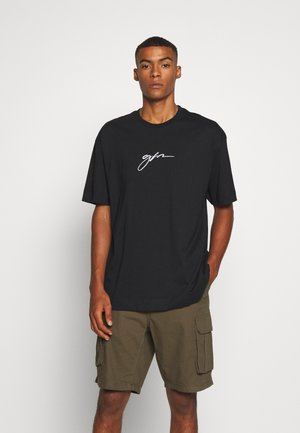 OVERSIZED SCRIPT - Print T-shirt - black