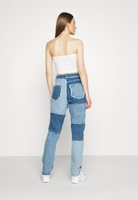 Missguided - FRAY HEM PATCHED - Straight leg jeans - blue - 2
