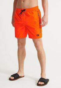 Superdry - SUPERDRY SWIMSPORT SHORTS - Swimming shorts - bright havana orange - 0