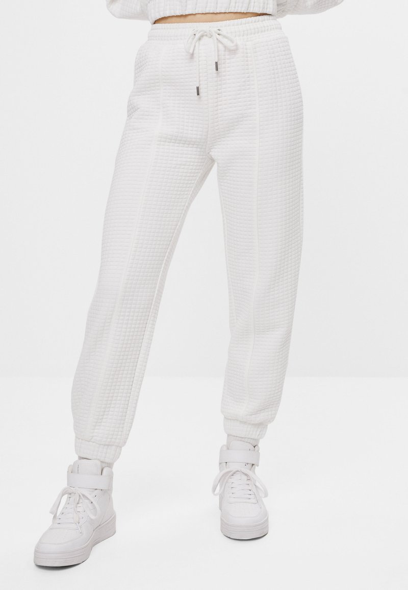 Bershka - Tracksuit bottoms - white