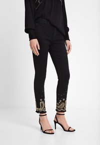 Desigual - DENIM_VIOLETA - Slim fit jeans - black - 0