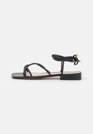 TEFFIK - Sandaalit nilkkaremmillä - black