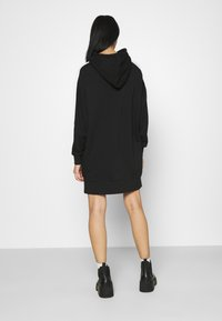 Puma - ICONIC HOODED DRESS - Day dress - black - 2