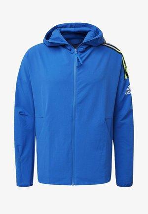ADIDAS Z.N.E. WOVEN HOODIE - Zip-up hoodie - blue