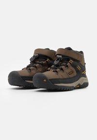 Keen - TARGHEE MID WP UNISEX - Hiking shoes - dark earth/golden brown - 1
