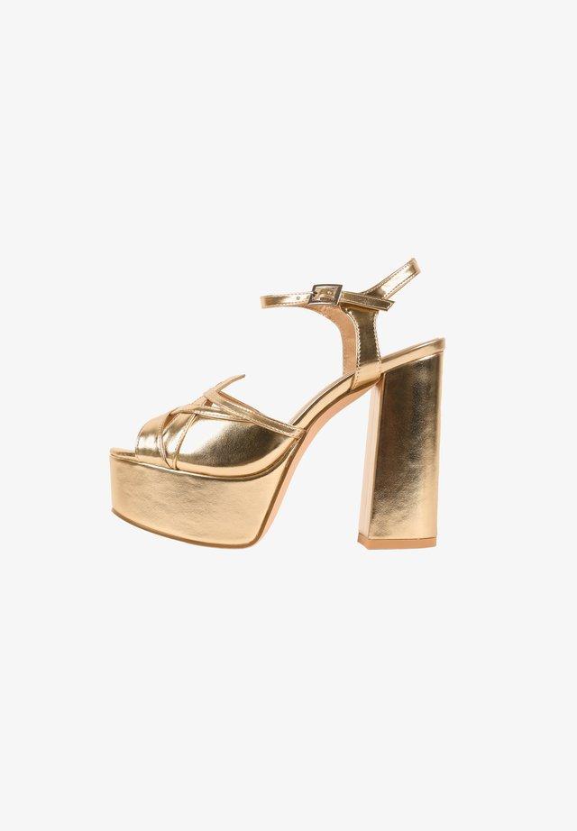 COSMOPOLITAN - Sandales à talons hauts - gold