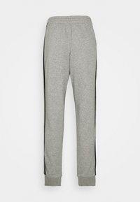 adidas Performance - Tracksuit bottoms - medium grey heather/black - 6