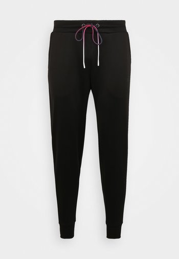 EXPOSE FADE - Tracksuit bottoms - black