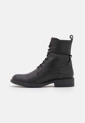 CATRIA - Lace-up ankle boots - black