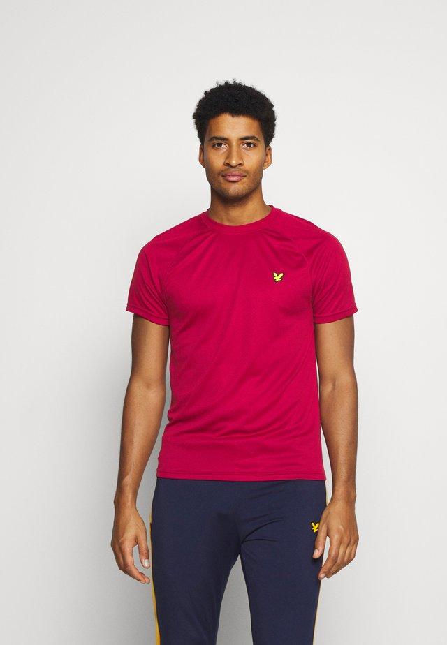 CORE RAGLAN - Jednoduché triko - ruby