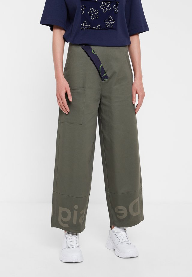 ARIANE - Trousers - green