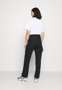 NU-IN - MARCUS BUTLER CARPENTER WIDE LEG - Straight leg jeans - black - 2