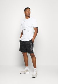 Nike Sportswear - Pantalon de survêtement - black/white - 1