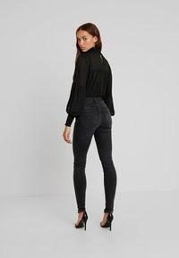 Vero Moda - VMLUX SUPER SLIM - Jeans Skinny Fit - black - 2