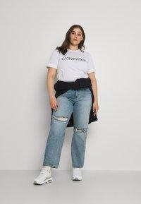 ONLY Carmakoma - CARINC ROBYN LIFE - Straight leg jeans - light blue denim - 1