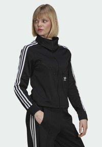 adidas Originals - ORIGINALS PRIMEBLUE TRACK SLIM - Giacca sportiva - black - 2